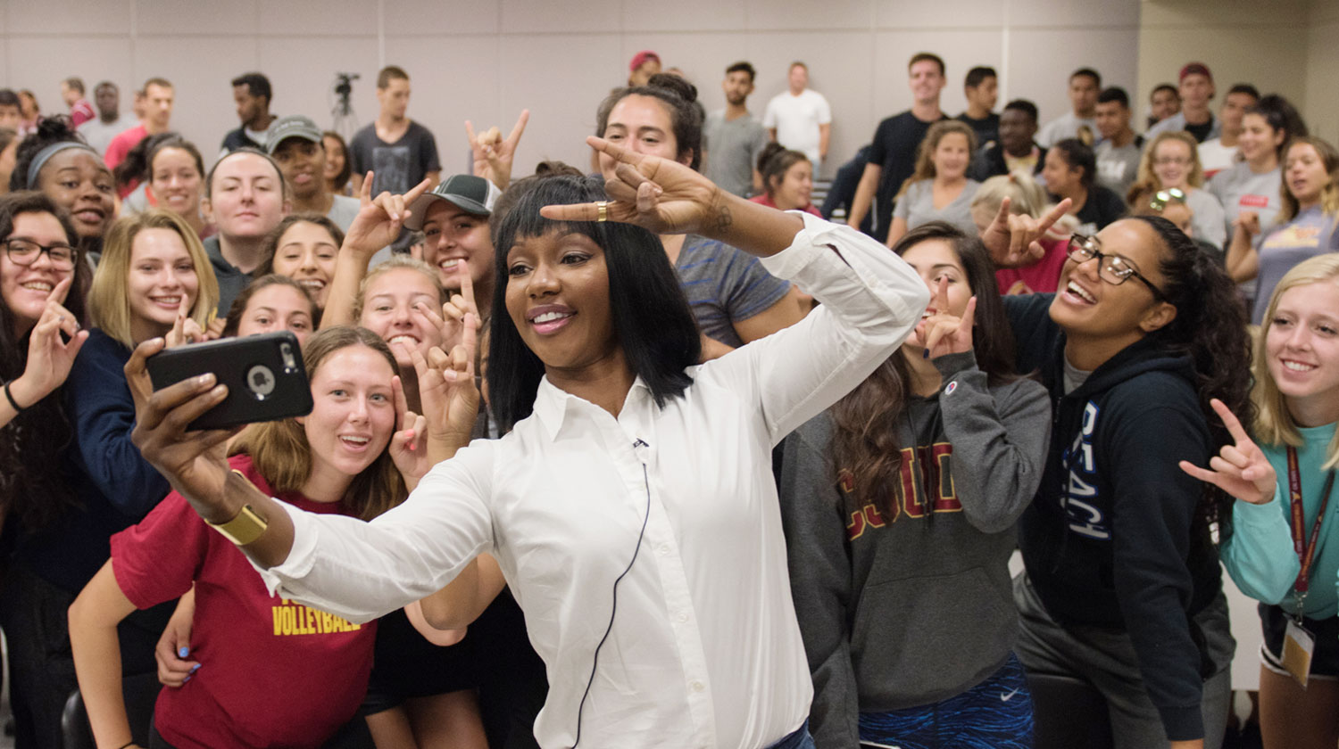 Photo of Carmelita Jeter taking a 'selfie' with CSUDH students