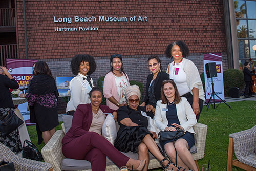 Alumni gather for a photo at the Long Beach Museum of Art
