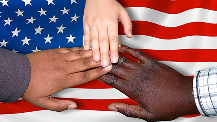 Three hands over the USA flag