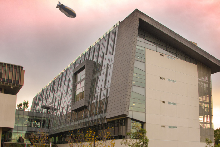 photography sample - csudh library with Goodyear blimp in sky in background