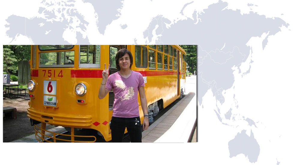student abroad in front of a train