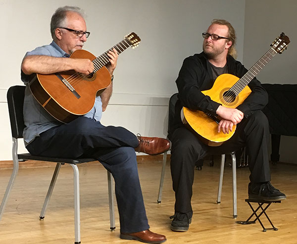 two classical guitar players