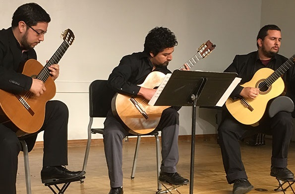 three classical guitar players