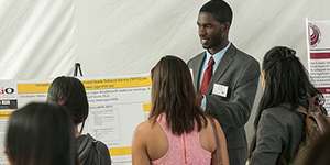 Male Student Presenting Posterboard