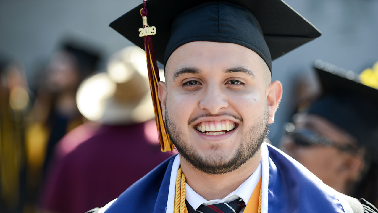 CSUDH Graduate. He's very happy.